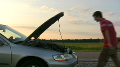 Man with broken down car on side of road - stock footage