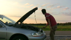 Man with Car trouble hitch hiking Stock Footage