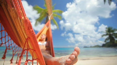 woman in hammock with palmtree audio - stock footage