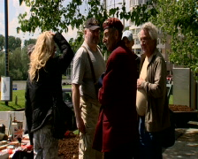 People talking to veteran near the Arnhem Bridge Stock Footage