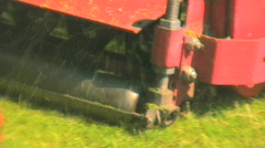 Cutting grass on the golf course during s sunny summer day Stock Footage