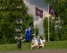 Man sitting in the sun at the Airborne monument near the Arnhem Bridge Stock Footage