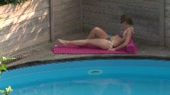Woman by the pool Stock Footage
