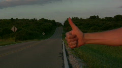 Thumb Hitch hiking on side of road Stock Footage