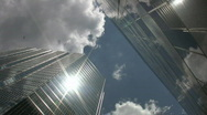 Stock Video Footage of Office towers. Sun and cloud reflections.