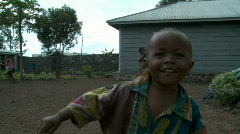 Happy African boy dressed in rags and other children Stock Footage