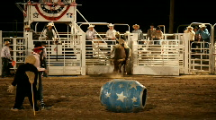 Bull rider stuck on bull at rodeo P HD 1002 Stock Footage
