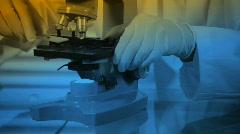 Male lab tech blue gel Stock Footage
