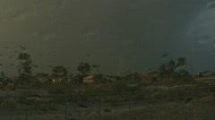 Rainbow through car windshield in the rain Stock Footage
