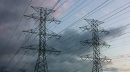 Stock Video Footage of Electrical pylons with timelapse clouds.