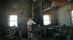 Blacksmith at bellows P HD 0780 Stock Footage