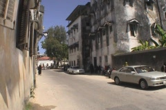 Street and houses people downtown Stonetown Zanzibar multi shots Stock Footage
