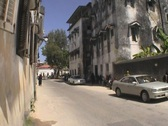 Stock Video Footage of Street and houses people downtown Stonetown Zanzibar multi shots