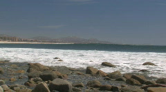 Rolling wave of tropical blue water curling on to rocks in Baja Mexico Stock Footage