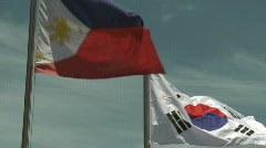 Philippine and South Korean Flag slow motion Stock Footage