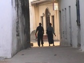 Stock Video Footage of People walking in narrow street in downtown Stonetown Zanzibar