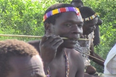 Hadsabe men making arrows in Tanzania - stock footage