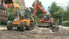 Two bulldozers passing eachother Stock Footage
