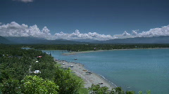 Pan over river inlet with town of Baler in the background Stock Footage