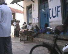 People sitting at a market table in Stonetown at Zanzibar island Stock Footage