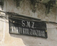 Street nameplate, clock and street Stonetown zanzibar QT Stock Footage