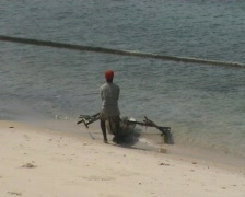 Men with a boat on the beach Stonetown Zanzibar  Stock Footage