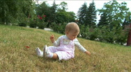Stock Video Footage of Little girl plays a lawn