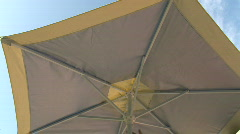 Closing Umbrella on Sunny Day Stock Footage