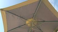 Closing Umbrella on Sunny Day Stock Footage