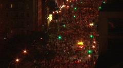 Massive crowds on city street at night 2 Stock Footage