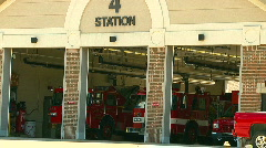 Township fire station - doors open and trucks waiting - stock footage