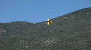 Stock Video Footage of Crop duster yellow mountain turn P HD 1043