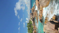 Rocky coastline of the seychelles vertical Stock Footage