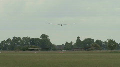 Glider plane landing frontal Stock Footage