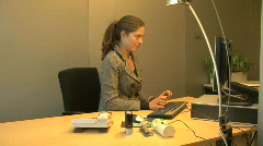 Secretarial work behind pc in a office Stock Footage
