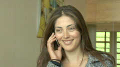 Woman speaking on her mobile Stock Footage