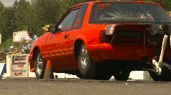 Motorsports, drag racing burnout, low angle through frame, Ford Mustang Stock Footage