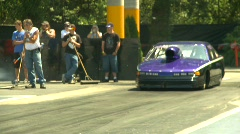 Motorsports, drag racing doorslammer burnout Stock Footage