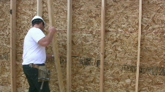 Young Man Building A Wall In A New Home Stock Footage