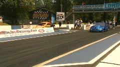 Motorsports, drag racing doorslammer launch Turbo Mustang vs 30s Chevy Stock Footage