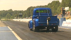 Motorsports, drag racing launch, 1950s Ford pickup, nice reverse angle Stock Footage