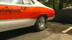 Motorsports, drag racing burnout, tights shot, Mopar Duster Stock Footage