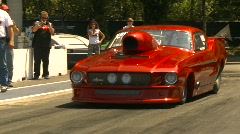 Motorsports, drag racing bright red Mustang promod burnout Stock Footage