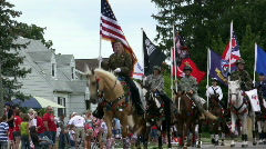 Horses with Flags in parade Stock Footage