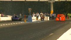 Motorsports, drag racing, mid track doorslammer, follow shot Stock Footage