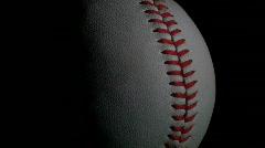 Baseball against black loop - HD Stock Footage