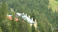 Stock Video Footage of Whistler condo zoom back to ski hill
