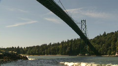 Marine transportation, cargo ship passes under Lions Gate bridge Stock Footage