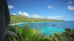 Pan shot tropical bay with ship Stock Footage