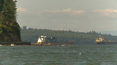 Marine transportation, cargo ship approaching, zoom back Stock Footage